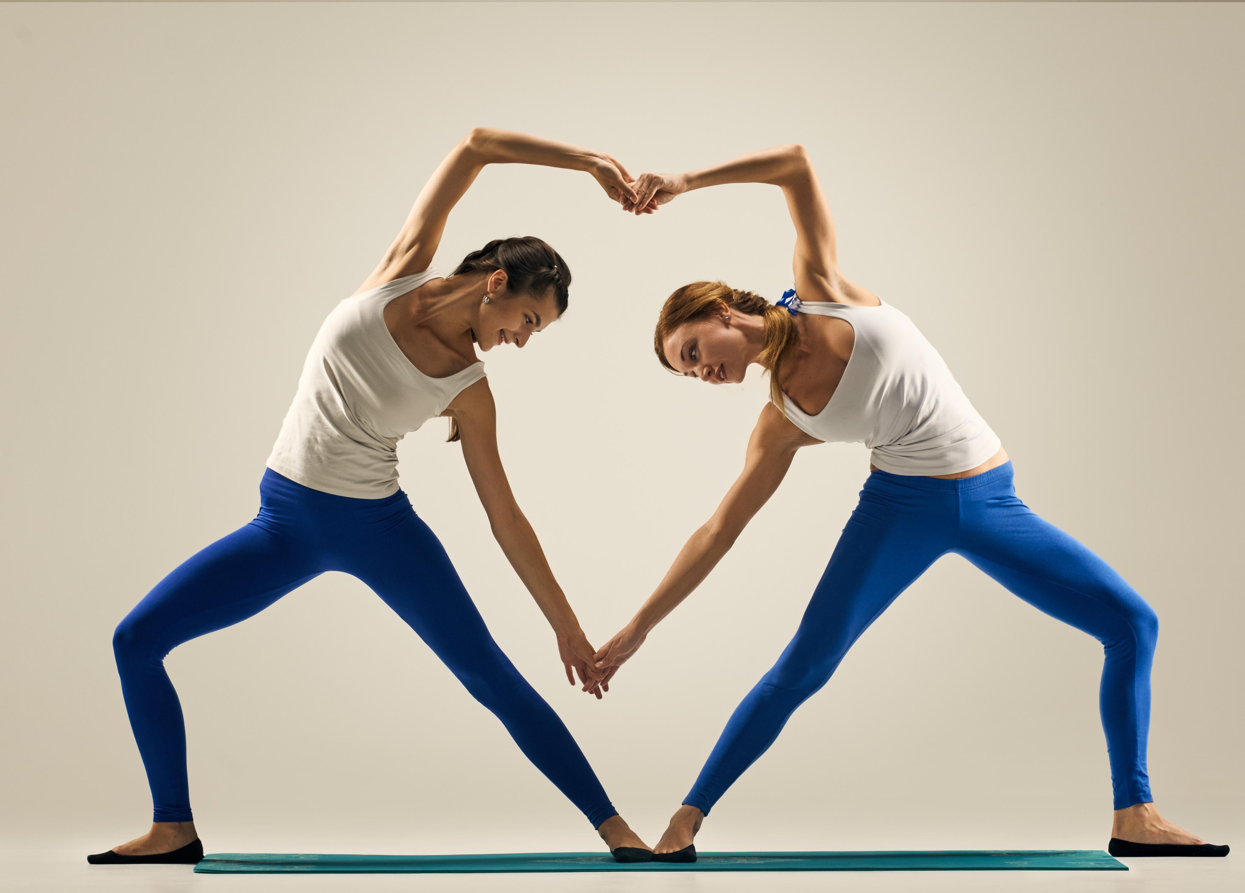 yoga in pair. heart - Replenish Yoga & Wellness  International